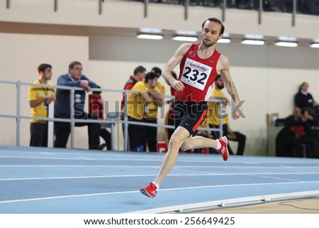 ISTANBUL, TURKEY - FEBRUARY 21, 2015: Turkish athlete Hasan Basri Guduk running during Balkan Athletics Indoor Championships in Asli Cakir Alptekin Athletics hall.