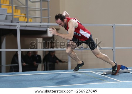 ISTANBUL, TURKEY - FEBRUARY 21, 2015: Turkish athlete Yavuz Can running during Balkan Athletics Indoor Championships in Asli Cakir Alptekin Athletics hall. - stock photo