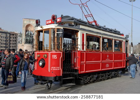 ISTANBUL, TURKEY - FEBRUARY 5: Vintage tram on the Taksim Street on February 5, 2015 in Istanbul, Turkey. Nostalgic tram of Istanbul is the heritage tramway system. It was re-established in 1990.