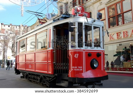 ISTANBUL, TURKEY - JAN 19, 2011 -  Old-fashioned red tram Nostalgia in Istanbul. It is the heritage tramway system. It was re-established in 1990 and gained much popularity - stock photo