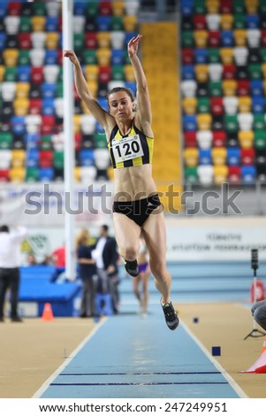 ISTANBUL, TURKEY - JANUARY 17, 2015: Athlete Busra Mutay triple jump during Ruhi Sarialp clubs jumping championship and athletics record attempt races in Asli Cakir Alptekin Athletics hall