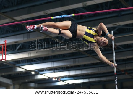 ISTANBUL, TURKEY - JANUARY 24, 2015: Athlete Demet Parlak pole vaulting during Turkish Athletic Federation Indoor Athletics Competition in Asli Cakir Alptekin Athletics hall - stock photo