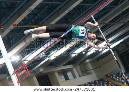 ISTANBUL, TURKEY - JANUARY 24, 2015: Athlete Hilal Kalkan pole vaulting during Turkish Athletic Federation Indoor Athletics Competition in Asli Cakir Alptekin Athletics hall - stock photo