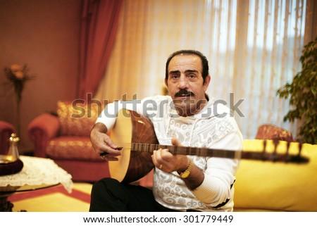 ISTANBUL, TURKEY - JANUARY 13: Famous Turkish musician, folk singer, songwriter and television star Mustafa Keser portrait on January 13, 2010 in Istanbul, Turkey. - stock photo
