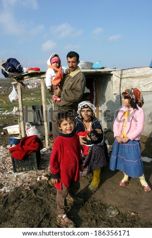 ISTANBUL, TURKEY - JANUARY 8: Gypsies family at Silivri Gypsy Camp on January 8, 2008 in Istanbul, Turkey. - stock photo