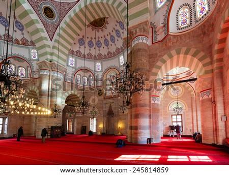 ISTANBUL, TURKEY - JANUARY 19,2015: Mihrimah Sultan Mosque in Uskudar interior. Muslim men praying in  Mihrimah Sultan Mosque in Istanbul on JANUARY 19,2015 in Istanbul, Turkey  - stock photo