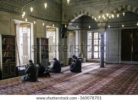 ISTANBUL, TURKEY - JANUARY 01: Muslims preparing during the prayer Sultanahmet Mosque on January 01, 2016 in Istanbul, Turkey. Blue Mosque, built in the 17th century by the architect Mehmet Aga. - stock photo