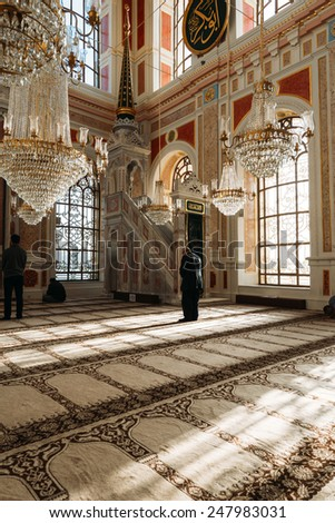 ISTANBUL, TURKEY - JANUARY 23: Ortakoy Mosque interior.Muslim men praying in a ortakoy mosque inside  on JANUARY 23, 2015 in Istanbul, Turkey .