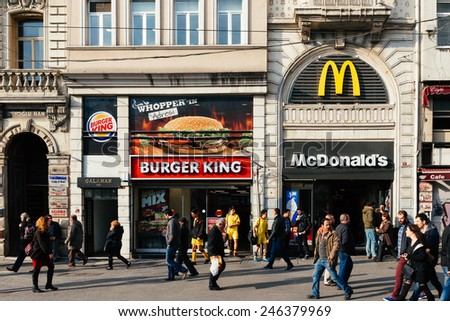 ISTANBUL, TURKEY - JANUARY 20: People walking at  Istiklal street in Istanbul.Burger King and Mc Donalds hamburger restaurant in istiklal street on January 20, 2015 in Istanbul, Turkey  - stock photo