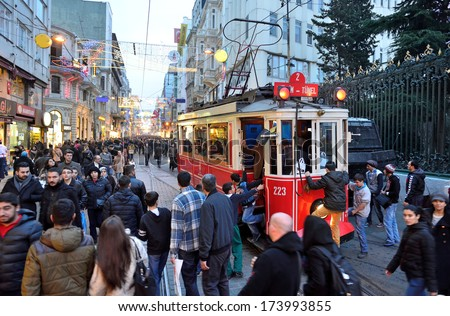 ISTANBUL, TURKEY - JANUARY 12: People walking on Istiklal Street January 12, 2014 in Istanbul Turkey. It is the most famous street in Istanbul visited by nearly 3 million people a single weekends day