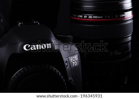 ISTANBUL, TURKEY - JANUARY 04, 2014: Photo of Canon containing 7D body and  24-105mm zoom lens on dark background. - stock photo