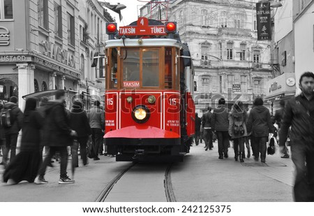 ISTANBUL, TURKEY - January 2: Taksim Istiklal Street at eventide on January 2, 2015 in Istanbul, Turkey. Taksim Istiklal Street is a popular destination in Istanbul. Nostalgic tram of Istanbul.  - stock photo
