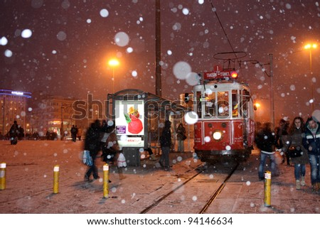 ISTANBUL, TURKEY - JANUARY 30 :Taksim istiklal street at eventide on January 30, 2012 in Istanbul,Turkey. Taksim Istiklal street is a popular tourist destination in Istanbul. - stock photo