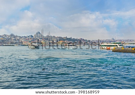 ISTANBUL, TURKEY - JANUARY 21, 2015: The cityscape of Istanbul from Galata bridge with many ferries, connecting the different banks, on January 21 in Istanbul.