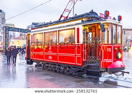 ISTANBUL, TURKEY - JANUARY 12, 2015: The old red tram on the Taksim-Tunel Nostalgia Tramway, on January 12 in Istanbul.