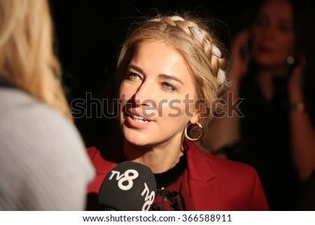ISTANBUL, TURKEY - JANUARY 16, 2016: Turkish presenter and actress Burcu Esmersoy in Tuvanam catwalk during Fashionist Fair. - stock photo