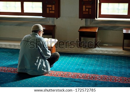 ISTANBUL, TURKEY - 19 JANUARY: Unknown man in the Tunahan Mosque a read Quran in Istanbul, Turkey on january 19, 2014. Tunahan mosque was made in 2004. - stock photo