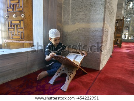 ISTANBUL, TURKEY - JULY 1: Edirnekapi Mihrimah Sultan Mosque in reading Koran child, 1 July 2016 in Istanbul Turkey. The Muslims who have made a tradition of reading Koran the month of Ramadan. - stock photo