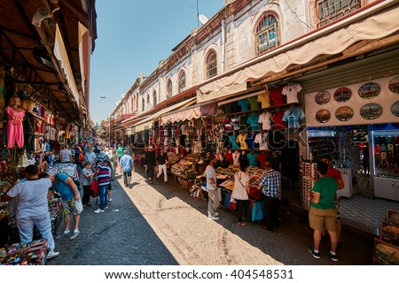 ISTANBUL, TURKEY - JULY 28, 2015: Eminonu and Grand Bazaar is popular destination for tourists in Istanbul.  - stock photo