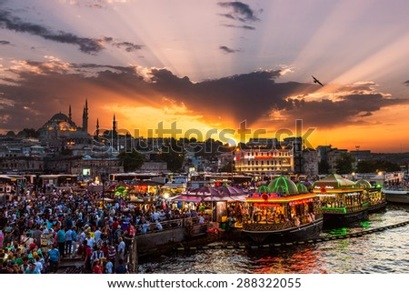 ISTANBUL, TURKEY - JULY 29: Hundreds of tourists and local Turks hang out along the Bosphorus as night comes on on July 29, 2014 in Istanbul, Turkey.
