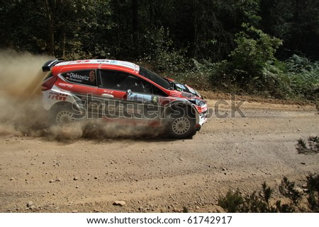 ISTANBUL, TURKEY - JULY 25: Maclej Oleksowicz drives a Castrol Trw Motointegrator Ford Fiesta S2000 car during Bosphorus Rally2010 ERC championship, Mudarli Stage on July 25, 2010 in Istanbul, Turkey - stock photo