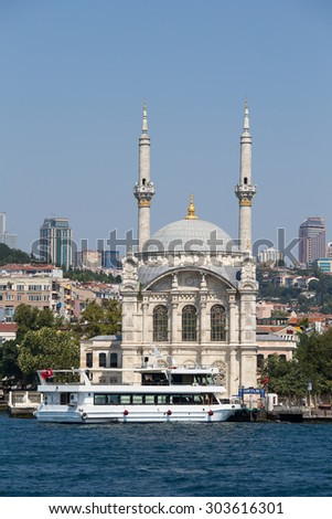 ISTANBUL, TURKEY - JULY 29, 2015 : Ortakoy Mosque in Besiktas district , Istanbul, Turkey, is situated at the waterside of the Ortakoy pier square, one of the most popular locations on the Bosphorus.