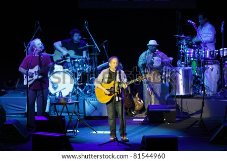 ISTANBUL,TURKEY - JULY 19 : Paul Simon and his band perform at Cemil Topuzlu Open Air Theater on July 19, 2011 in Istanbul, Turkey - stock photo
