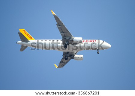 ISTANBUL, TURKEY - JULY 26, 2015: Pegasus Airlines Airbus A320-216 (CN 6619) landing to Sabiha Gokcen Airport. Pegasus Airlines has 83 fleet size and more than 86 destinations - stock photo