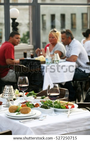 ISTANBUL, TURKEY - JULY 8: People eating Turkish food in the restaurant on July 8, 2010 in Istanbul, Turkey.