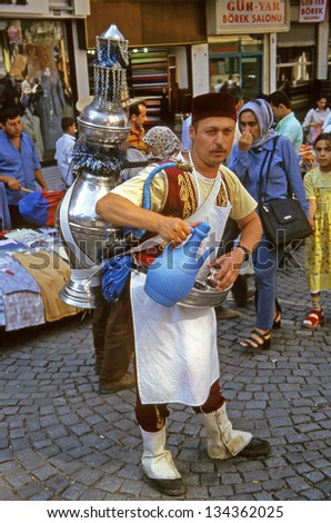 ISTANBUL,TURKEY- JULY 18: Street Vendors offers drinking water on July 18, 2000 in Istanbul,Turkey. Istanbul not lose anything of its oriental atmosphere. - stock photo