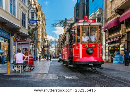 ISTANBUL, TURKEY - JULY 31, 2014: The Taksim-Tunel Nostalgia Tram trundles along the streets of Taksim on July 31, 2014 in Istanbul, Turkey. - stock photo
