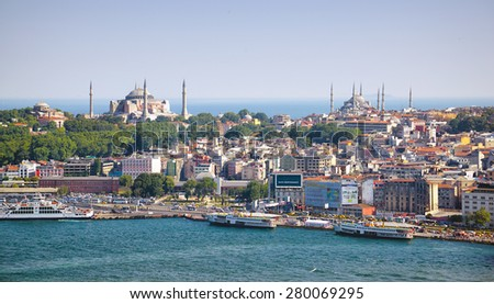 ISTANBUL, TURKEY - JULY 9, 2014: The view from Galata Tower to the south shore of Golden Horn with Hagia Sophia and Blue Mosque, Istanbul, Turkey