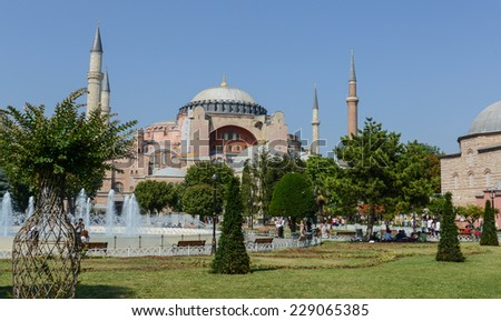 ISTANBUL, TURKEY - JULY 09, 2014: Tourists walk in Sultanahmet Square. More than 10 million people visit the city every year.