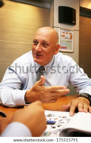 ISTANBUL, TURKEY - JULY 14: Turkish businessman and Turkcell CEO Sureyya Ciliv portrait on July 14, 2008 in Istanbul, Turkey. He has the position of CEO of the Turkcell since January 9, 2007.