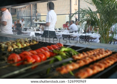 ISTANBUL, TURKEY - JULY 8: Turkish kebabs and vegetables on the Turkish barbecue in the restaurant on July 8, 2010 in Istanbul, Turkey.