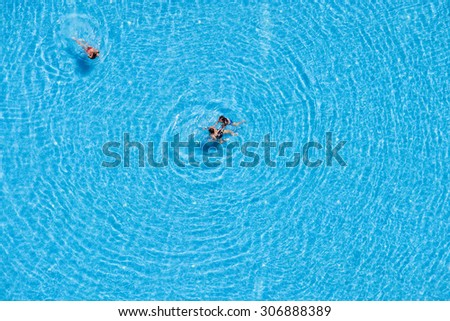 ISTANBUL, TURKEY - JULY 15, 2015 :  Unidentified people swim in the pool at the hotel. View from above. Turkey is one of the most attractive destinations for tourists - stock photo