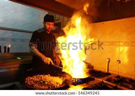 ISTANBUL, TURKEY - JUNE 14: A chef cooking traditional Turkish food 'Sac kebab' on June 14, 2012 in Istanbul, Turkey.