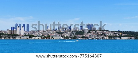 ISTANBUL, TURKEY - JUNE 25, 2017: A speed boat sailing through Istanbul's European side on Bosporus.
