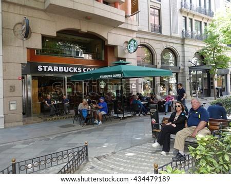 ISTANBUL,TURKEY-JUNE 09,2016:A Starbucks Coffee house located in Nuruosmaniye District,istanbul. Starbucks Corporation is an international coffee and coffeehouse chain based in Seattle, Washington.  - stock photo