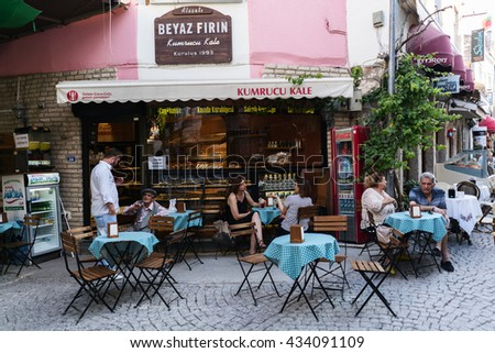 ISTANBUL,TURKEY-JUNE 07,2016:Alacati is small Aegean town on the western coast of Izmir Province in Turkey,which has been famous for its restaurants in streets, architecture, vineyards and windmills.  - stock photo