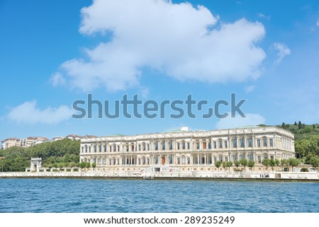 ISTANBUL, TURKEY, JUNE 8, 2013 : Exterior shot of Ciragan Palace, a former Ottoman palace, is now a five-star hotel in the Kempinski Hotels chain. It is located on the European shore of the Bosporus. - stock photo