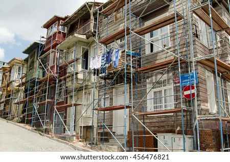 ISTANBUL, TURKEY - JUNE 5, 2016: Historic wooden homes being renovated in the Western suburb Edirnekapi in Istanbul.  - stock photo