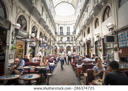ISTANBUL,TURKEY, JUNE 11,2015: Interior shot from Cicek Pasaji (Flower Passage) a famous historic passage with  historic cafes, winehouses and restaurants, situated on Istiklal Avenue, Beyoglu. - stock photo