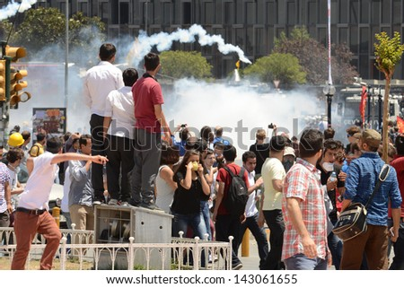 ISTANBUL, TURKEY - JUNE 11: Mass protests shown on June 11 2013 in Taksim Square - stock photo