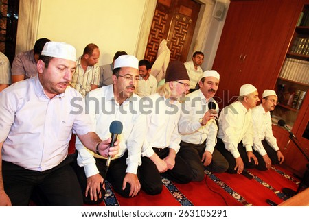 ISTANBUL, TURKEY - JUNE 23: Mosque preachers praying at Ramadan night in Validei Atik Mosque on June 23, 2013 in Istanbul, Turkey.  - stock photo