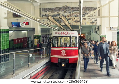 ISTANBUL, TURKEY, JUNE 11, 2015: People leaving the vagon at Beyoglu Tunel, a short historic underground railway line in Istanbul with two stations, connecting the quarters of Karakoy and Beyoglu. - stock photo