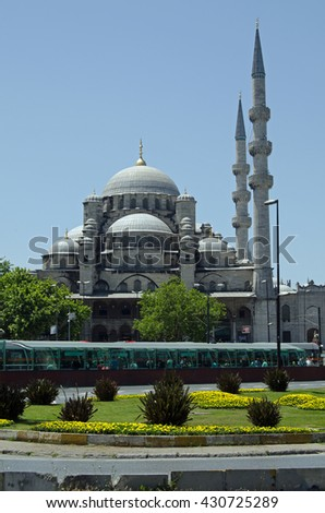 ISTANBUL, TURKEY - JUNE 2, 2016:  The historic Yeni Cami Mosque dominating the water side of the old city of Istanbul, Turkey on a sunny afternoon in June. - stock photo
