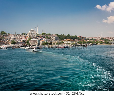 ISTANBUL, TURKEY - JUNE 20: Tourist ship near Galata Bridge on June 20, 2015 in Istanbul, Turkey - stock photo
