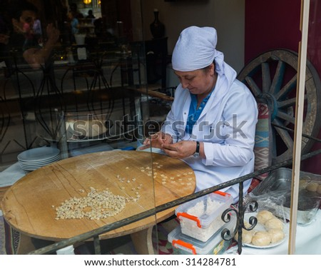 ISTANBUL, TURKEY - JUNE 20: Turkish woman preparing food on June 20, 2015 in Istanbul, Turkey
