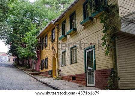 ISTANBUL, TURKEY - JUNE 5, 2016: Wooden homes on a steep road in Edirnekapi, a suburb in the west of Istanbul, Turkey.